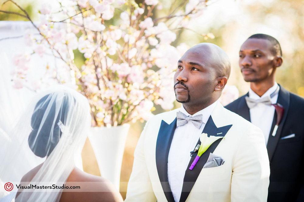 Groom Exchanging Vows at Skylands Manor by Visual Masters