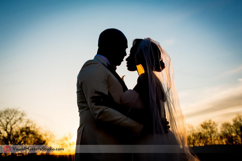 Bride and Groom Having an Intimate Moment at Skylands Manor by Visual Masters