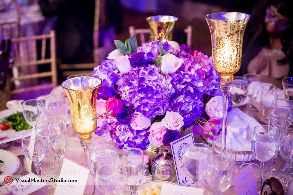 Prurple Wedding Table Flower Arrangelments at Skylands Manor by Visual Masters