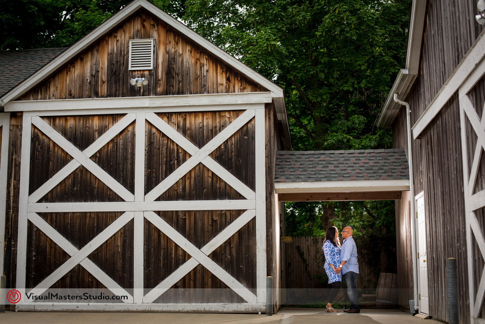 Couple Enjoying Moment Alone next to the Rustic Barn