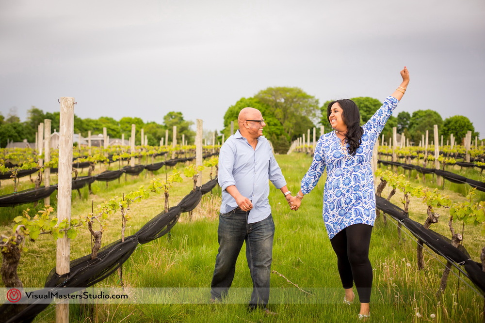 Happy Couple Running Trough The Vine Groves