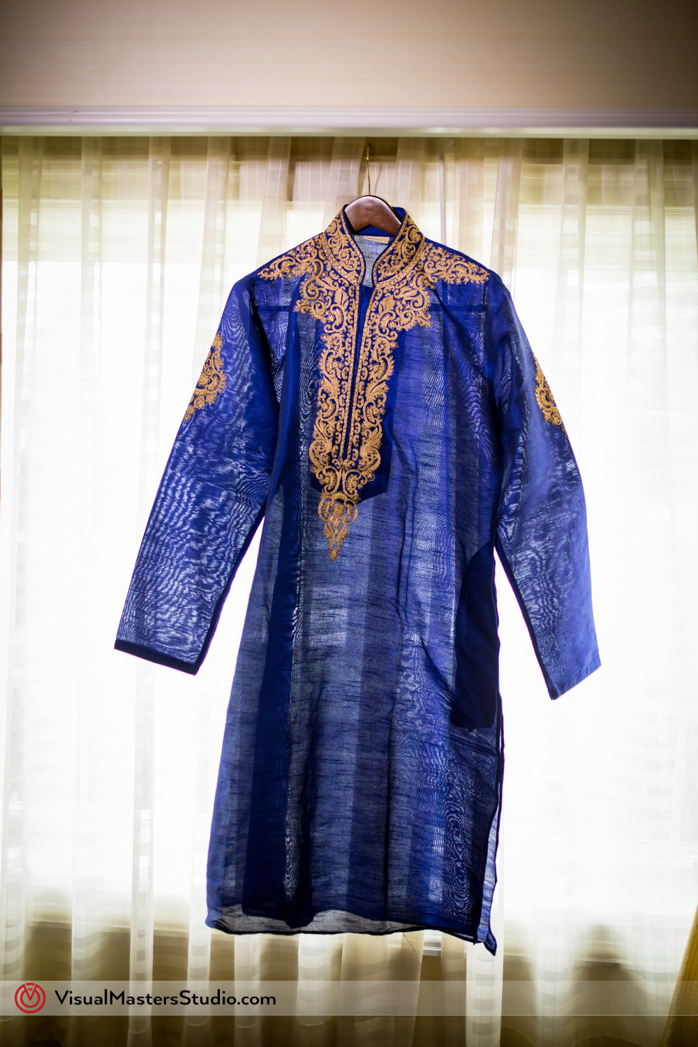 Blue Sherwani by Visual Masters