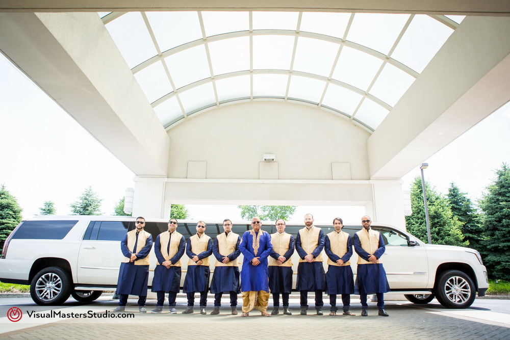 Broomsman and White Escalade Limo by Visual Masters