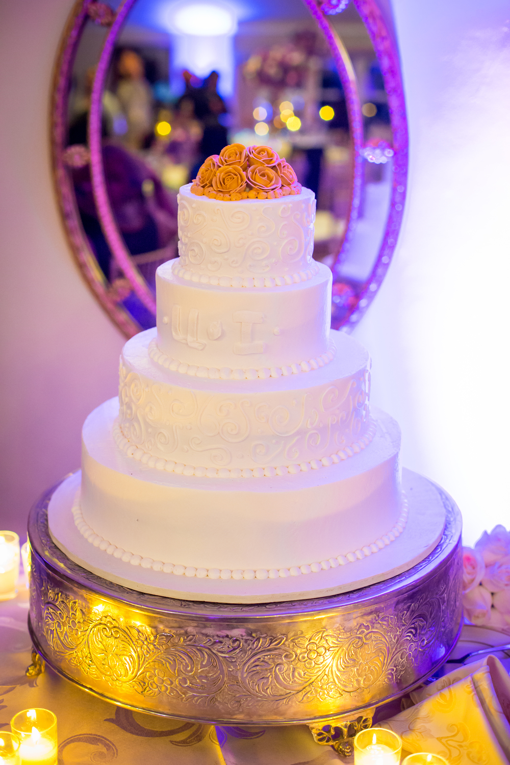 White Wedding Cake with Orange flowers by Visual Masters