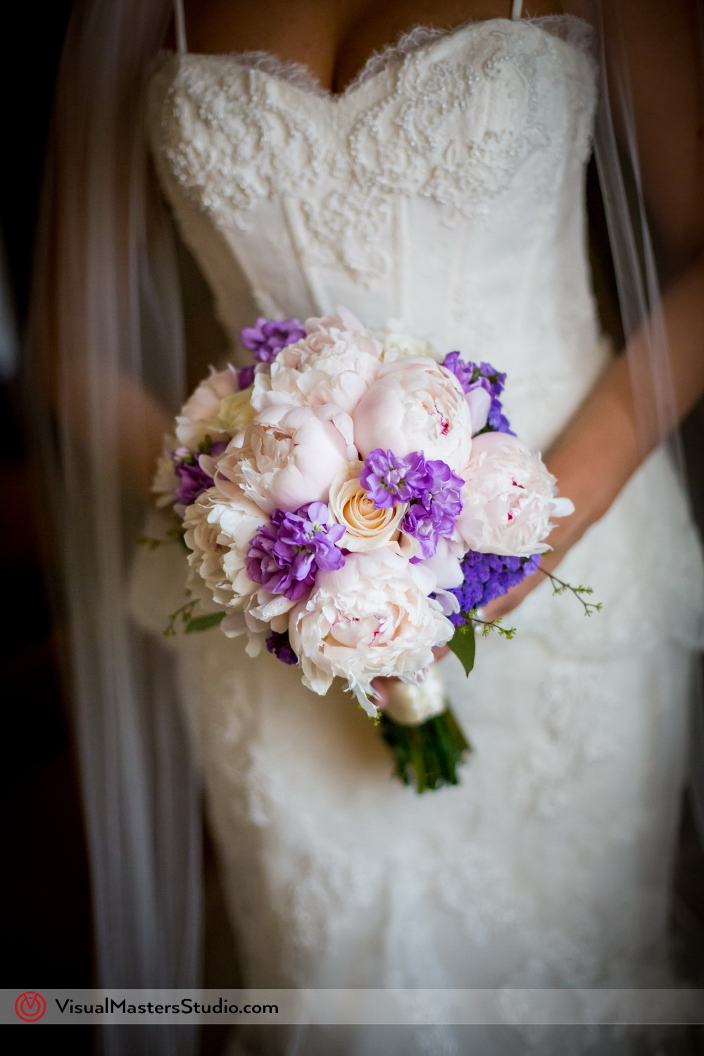 White Pink and Purple Bridal Bouquet by Visual Masters