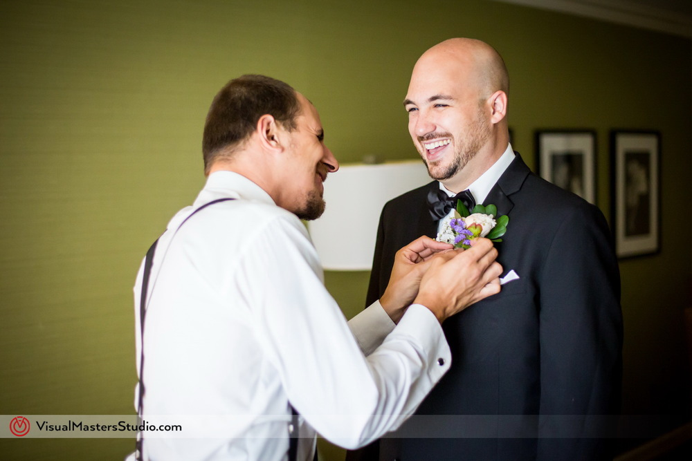 Purple and White Boutonniere by Visual Masters