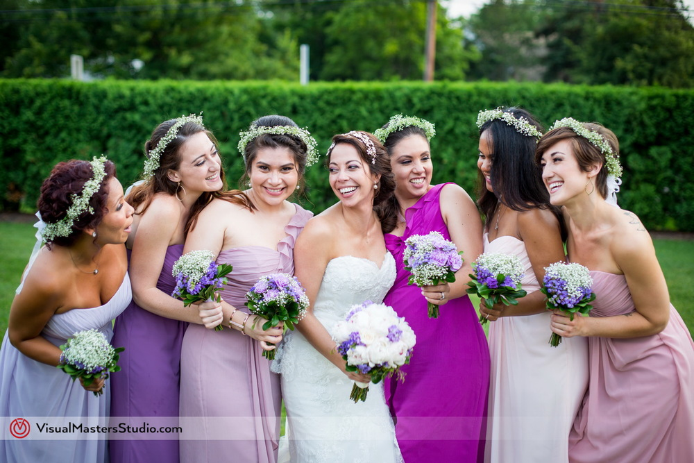 Bride Posing With Bridesmaids at Westminister Hotel by Visual Masters