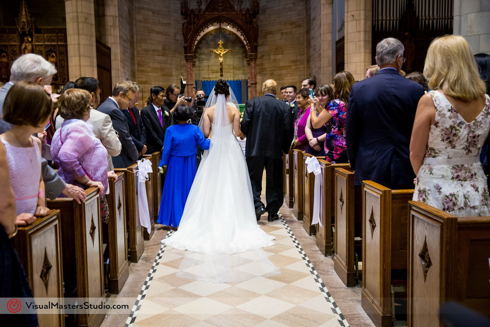 Bride Walking Down the Aisle at Our Lady of Sorrows by Visual Masters