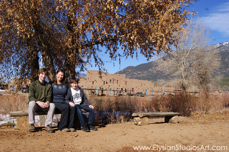 Exploring the beautiful grounds of Taos Pueblo with my sons