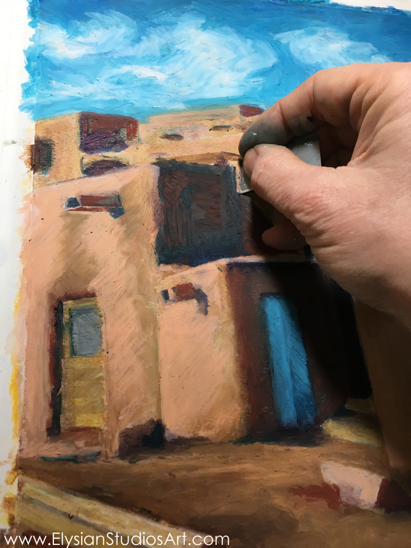 Scraping oil pastel from the surface of the drawing