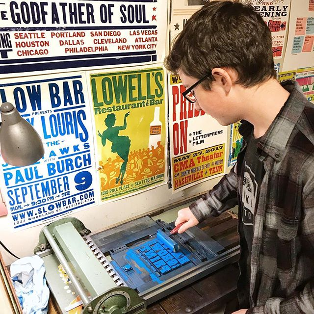 Even when we travel, we have to make art!  Our family toured @hatchshowprint on our recent visit to Nashville.  Luke is rolling out some oil based ink onto vintage wood block type before he uses the antique press to print his image. • • • • • #hatchprint #nashville #nashvilletn #musiccity #creatorslane #makersgonnamake #familyadventures #oneofthebunch #printmakingart #travelgram #traveldiaries #printstudio #printstagram #photosinbetween #printmaking #visualsoflife #visualcrush #thursdayfunday #artthursday #artislife #lifeisart  #livecolorfully #creativehappylife #creatorsofart #livethelifeyoulove #artprocess #printpress #printingpress #exploreinbetween #ElysianStudios
