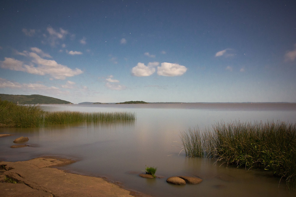 A praia, com a vista para as ilhas e o canal. Ao fundo, a entrada da Lagoa dos Patos.