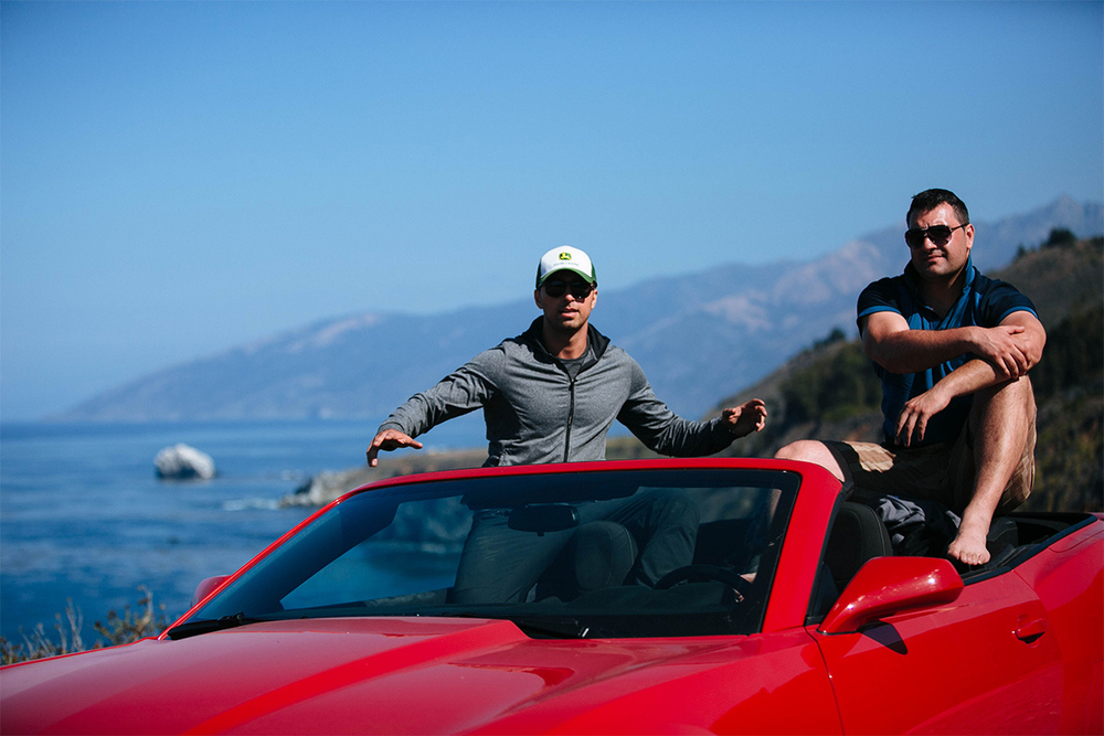 Pulled over on the side of the PCH (Pacific Coast Highway), tripod out and striking several poses in our Camero