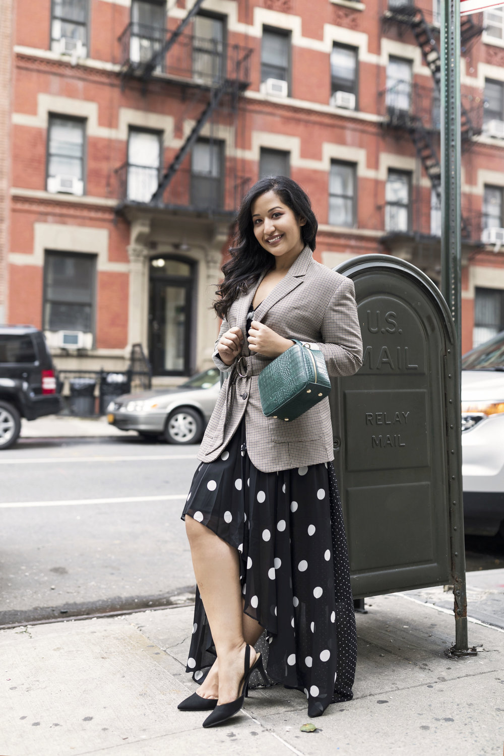 Throw on your favorite blazer on top of a dress - Chic and subtle with one step