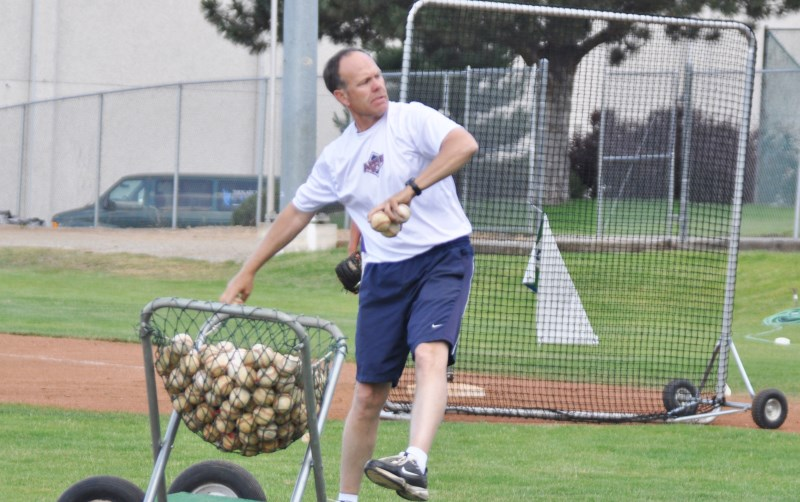 Coach Knaggs throws to the 2014 AppleSox on day one of practice prior to the 2014 season. Photo by: Al Grieve - AppleSox Team Photographer