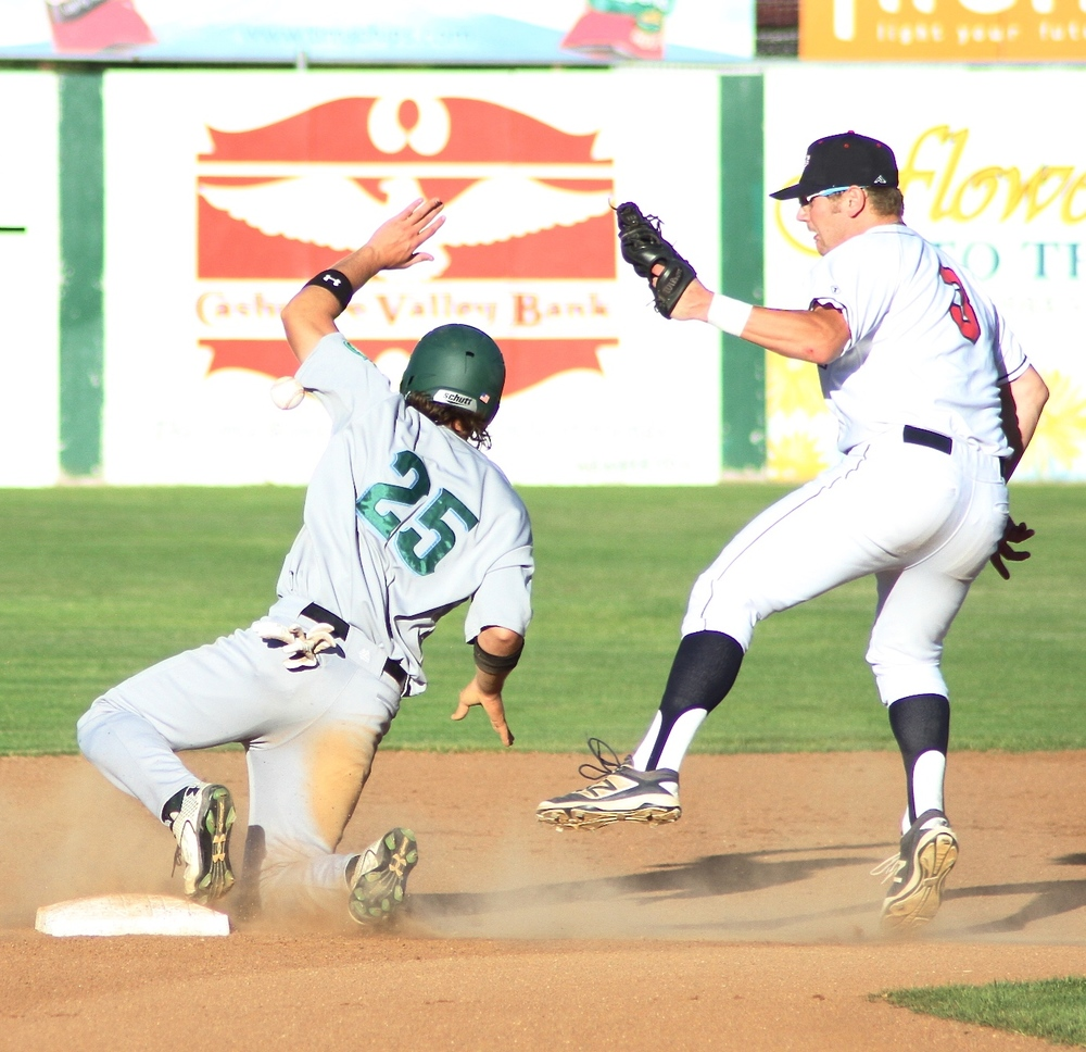 Wenatchee AppleSox shortstop Evan Douglas completes a sweeping tag at second base against the Yakima Valley Pippins in the early innings of a 6-1 loss, Friday night at Paul Thomas Sr. Stadium.