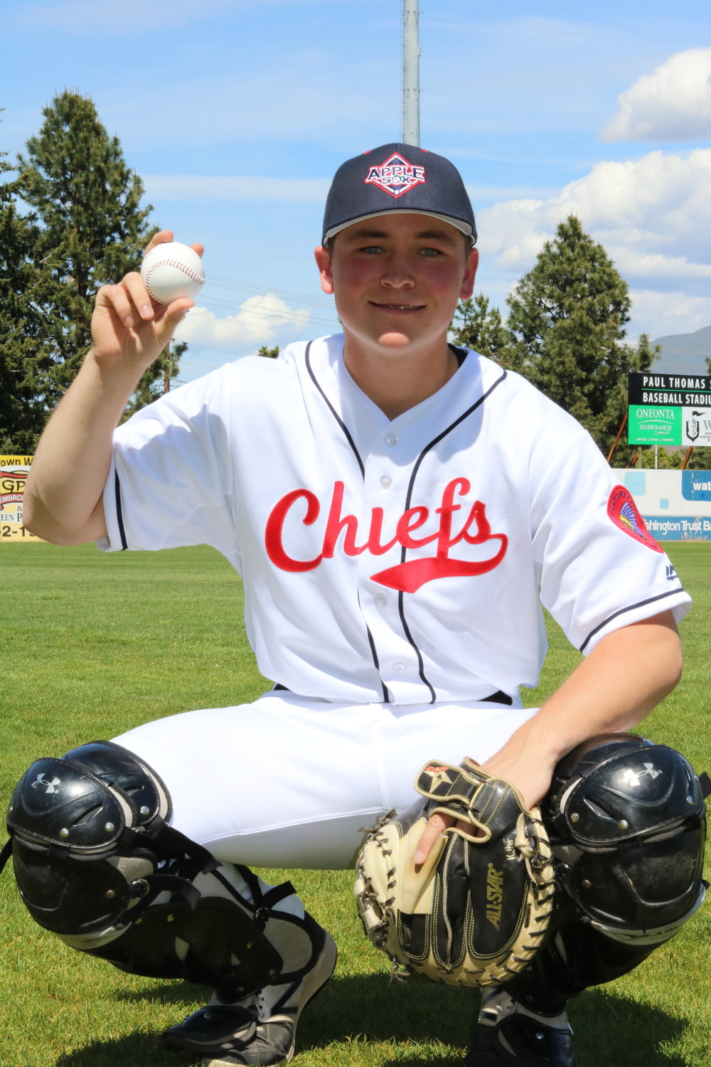AppleSox bullpen catcher and Wenatchee native, Cody Simmons, models the 1937 replica Wenatchee Chiefs uniform the AppleSox have been wearing this season.