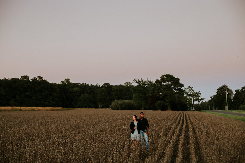 Delaware-Photographer walking during golden hour in a field