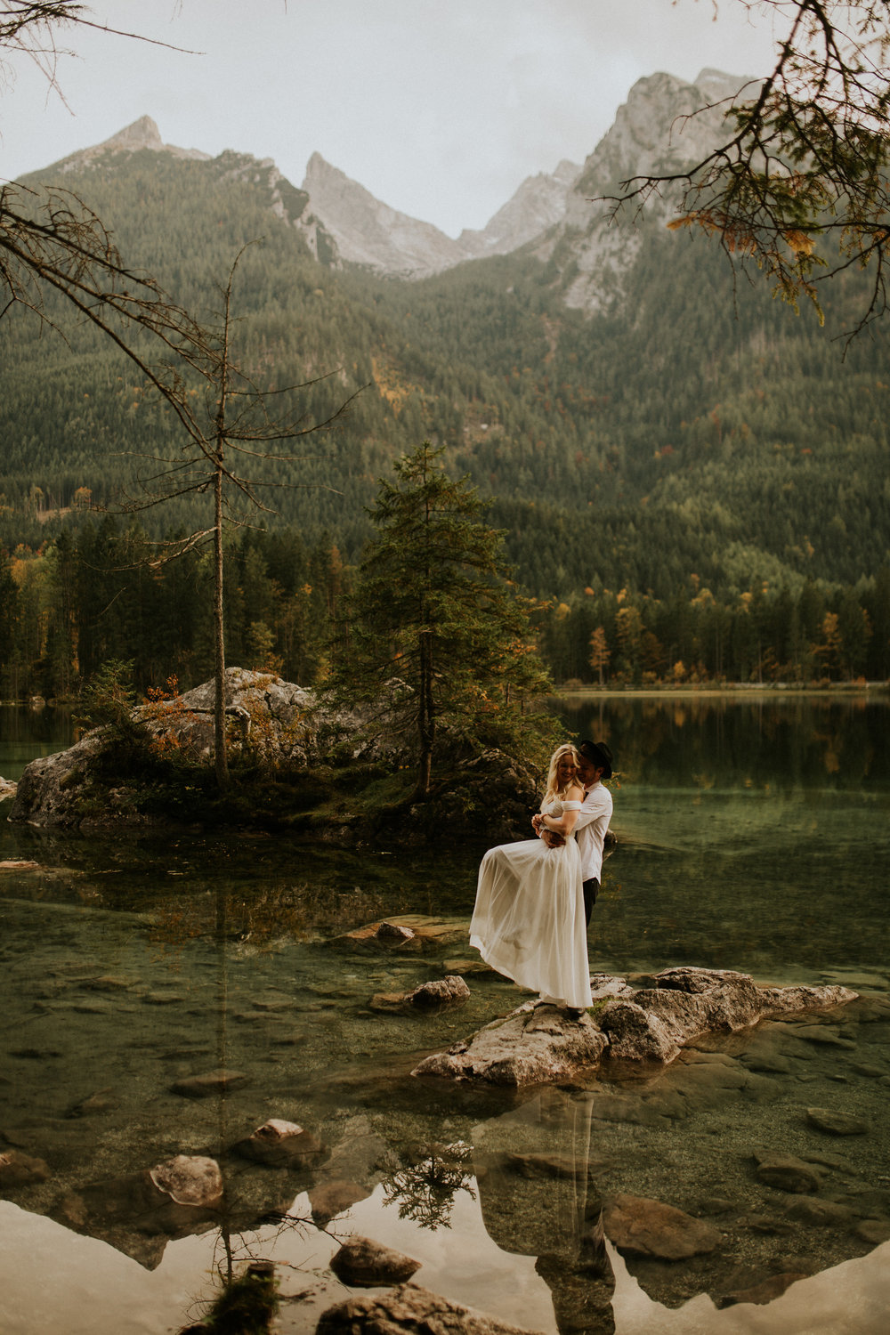 Hannah and Hannes engagement photos on a lake in Hintersee, Germany