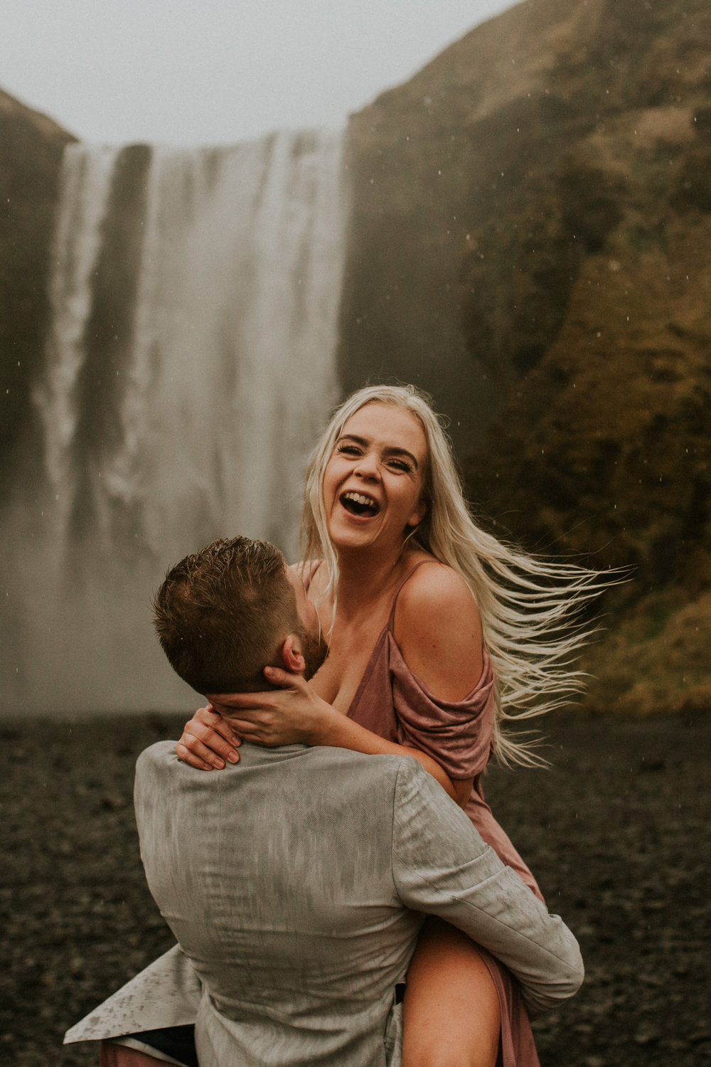 icelandic couple Rebecca and Steinar at skogafoss by BreeANna LAsher