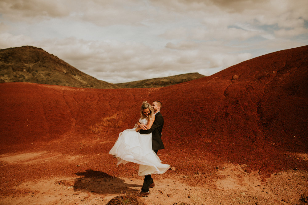 the painted hills in oregon elopement in the sun