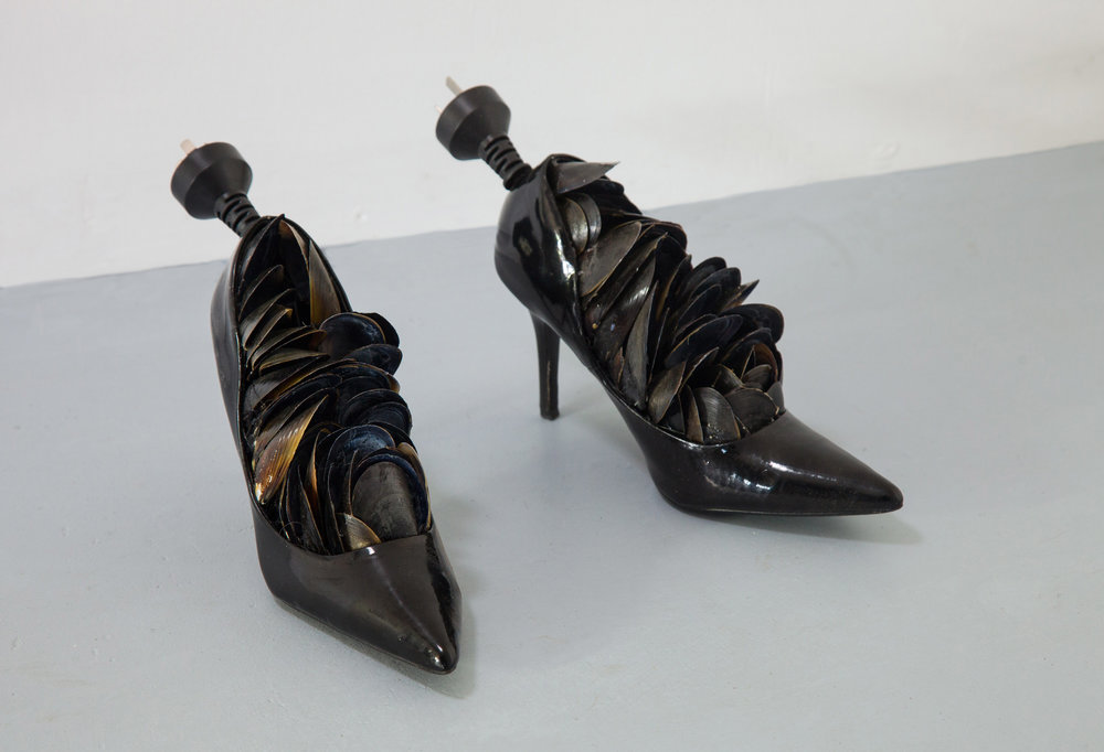 Dance Me to the End of Night, 2016, (detail, installation view) mussel shells, found shoes, electric cable (photo: Mark Sherwood)*