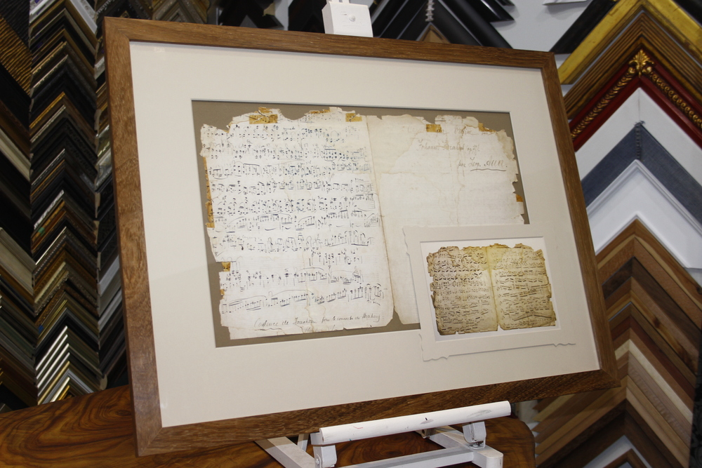 Conservation framing of antique sheet music