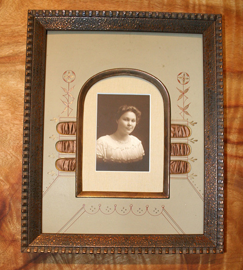 Antique photo framed with antique matting