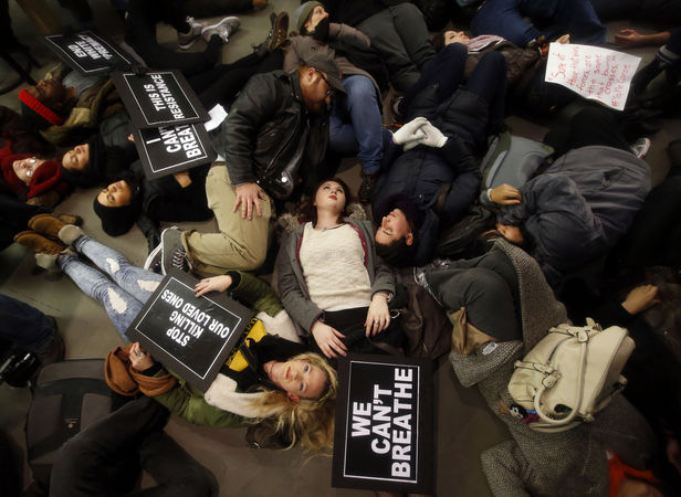 "Protestors stage a ""die-in"" at an Apple store in New York City Friday December 5 to protest the grand jury's decision not to indict the officer who killed Eric Garner, photo JasonDeCrow/AP"