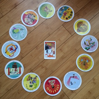 Astrological spread containing  Aquarian Tarot Deck  and  Motherpeace Tarot Deck  cards