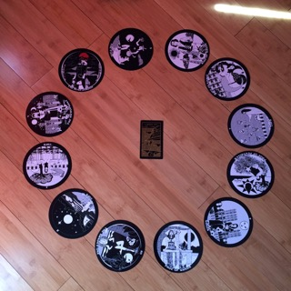 Astrological spread containing  The Gorgon's Tarot  and  Golden Thread Tarot  cards