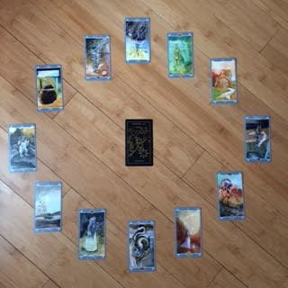 Astrological spread using  The Fairy Light Tarot  and  Golden Thread Tarot