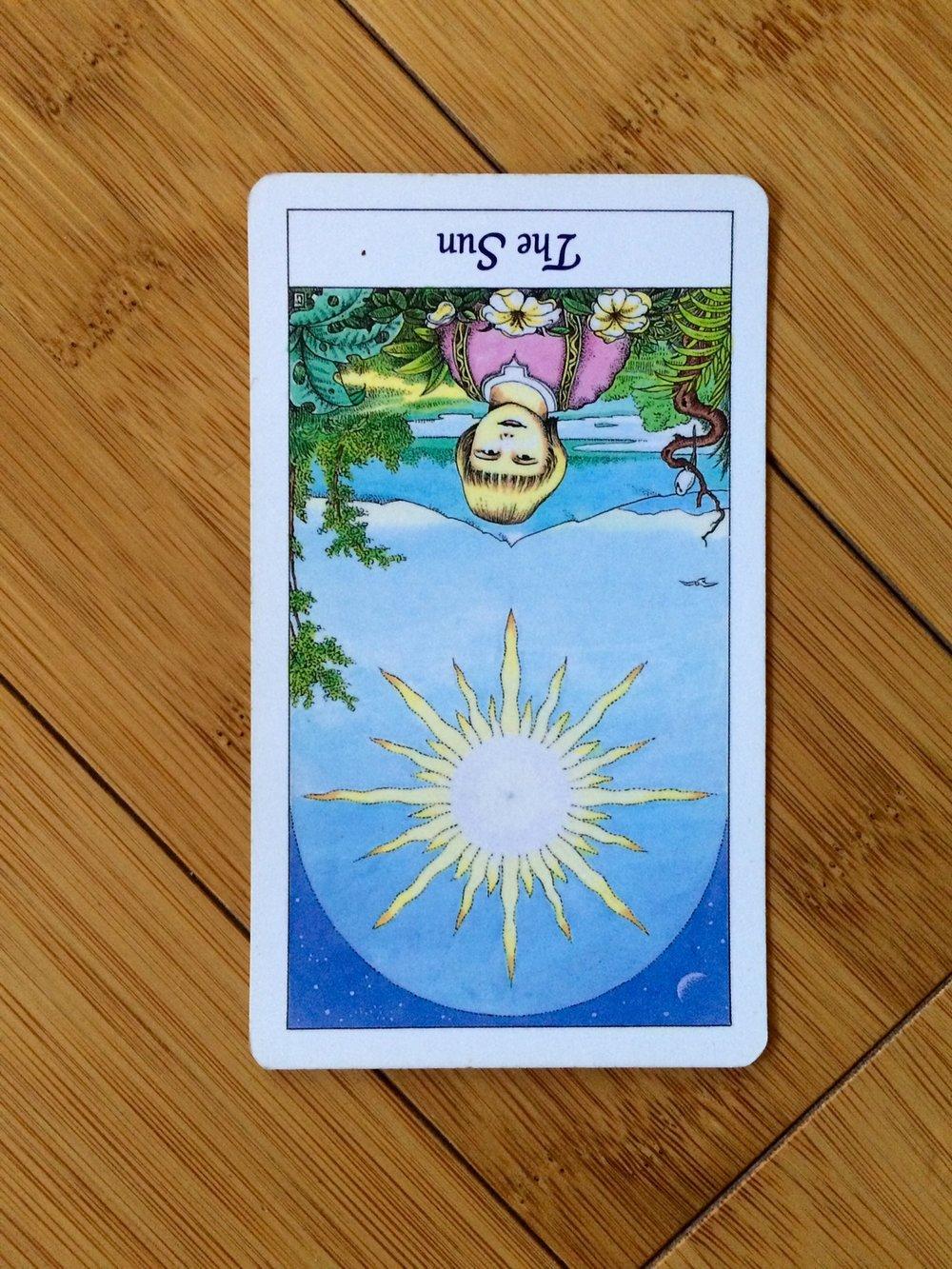 The Sun reversed,  Cosmic Tarot