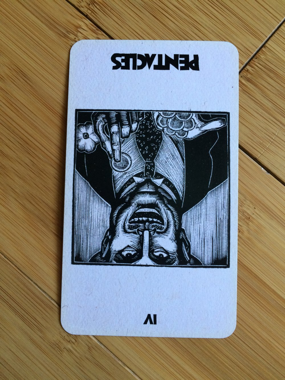 Four of Pentacles reversed from  The Lynd Ward Tarot