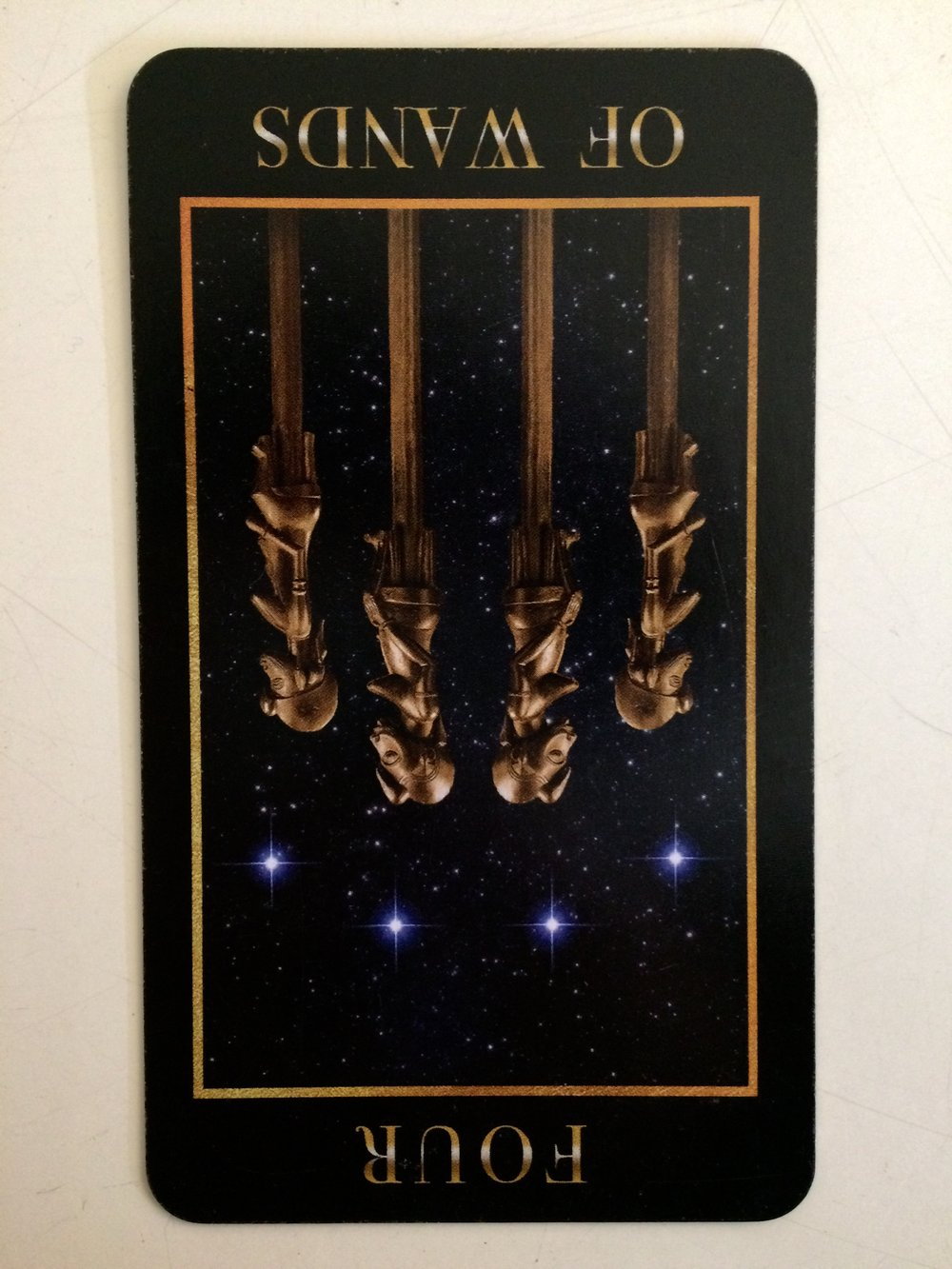 Four of Wands reversed from  Manzel's Tarot