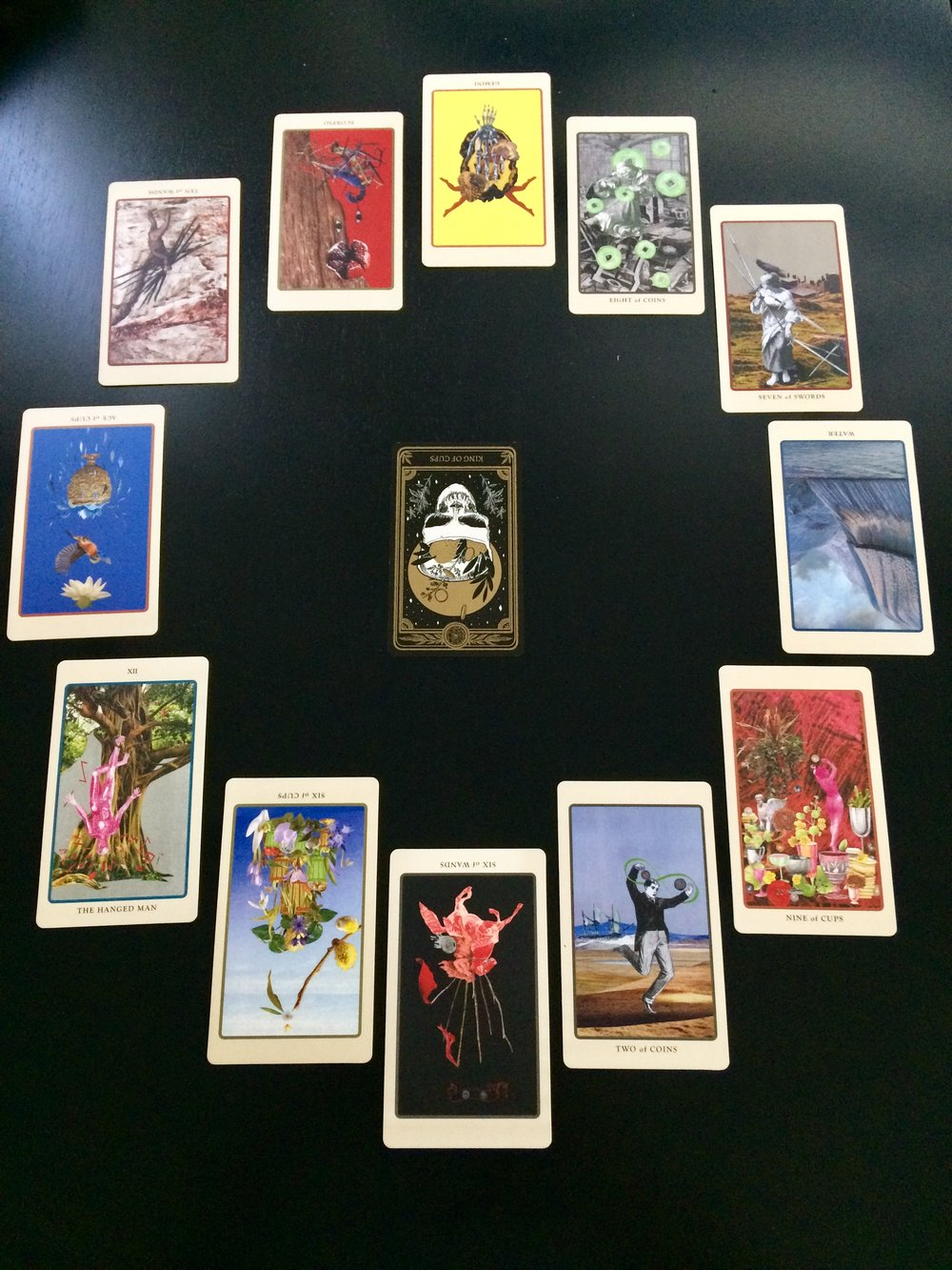 Astrological spread using cards from  The Marigold Tarot  and  Spolia Tarot