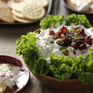 It is always important to have snacks for your guests to munch on while you grill or prepare dinner, and this BLT Dip will sure keep them busy. This fun take on the fan-favorite BLT sandwich is easy to transport, but it will get scooped up quick! Get the recipe at tasteofhome.com,  here .