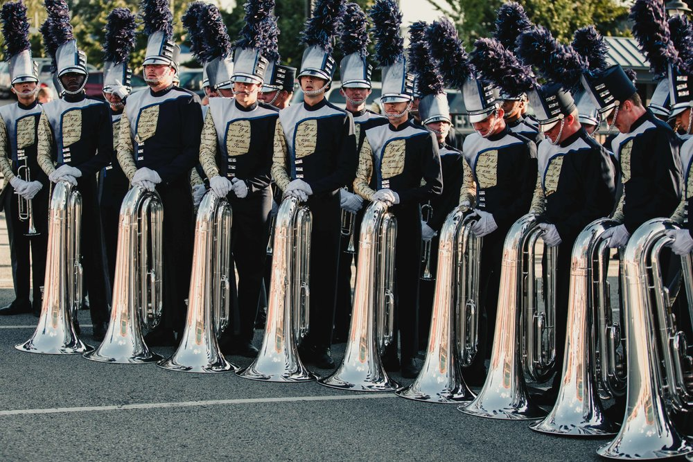 The Blue Stars Tuba Section, shocked and unsure of what to do with their new found useless pieces of metal