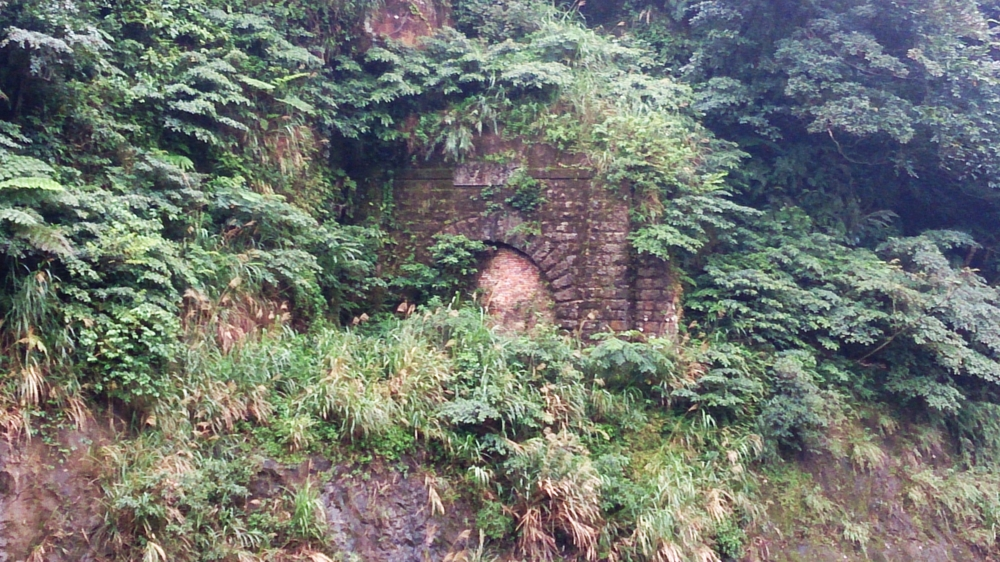 Old tunnel portal next to the mainline bridge.