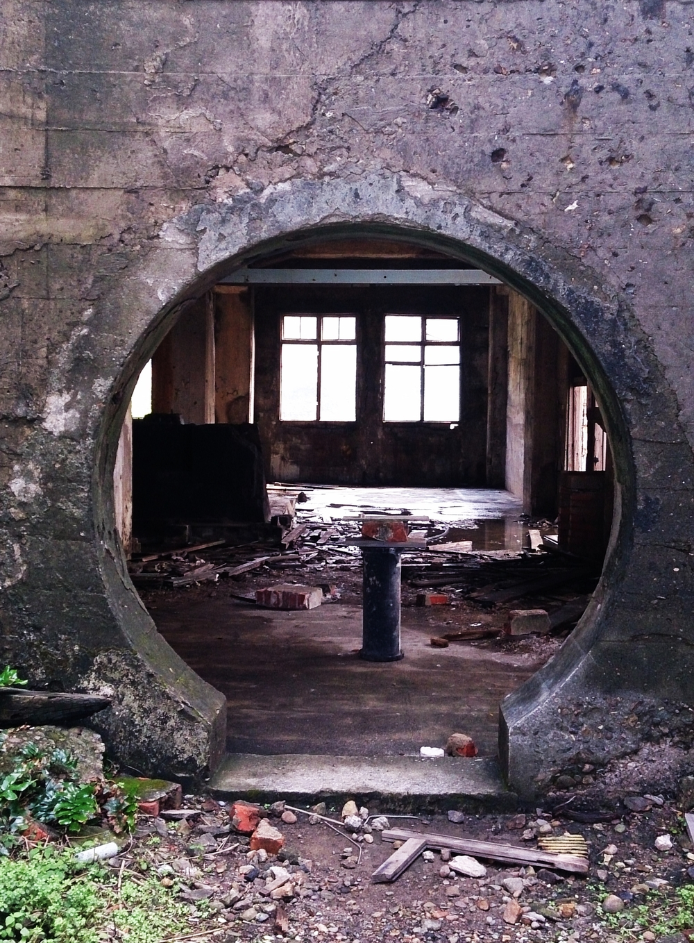 Railway to nowhere. The top floor portal. A mineral encrusted funnel under the arches.