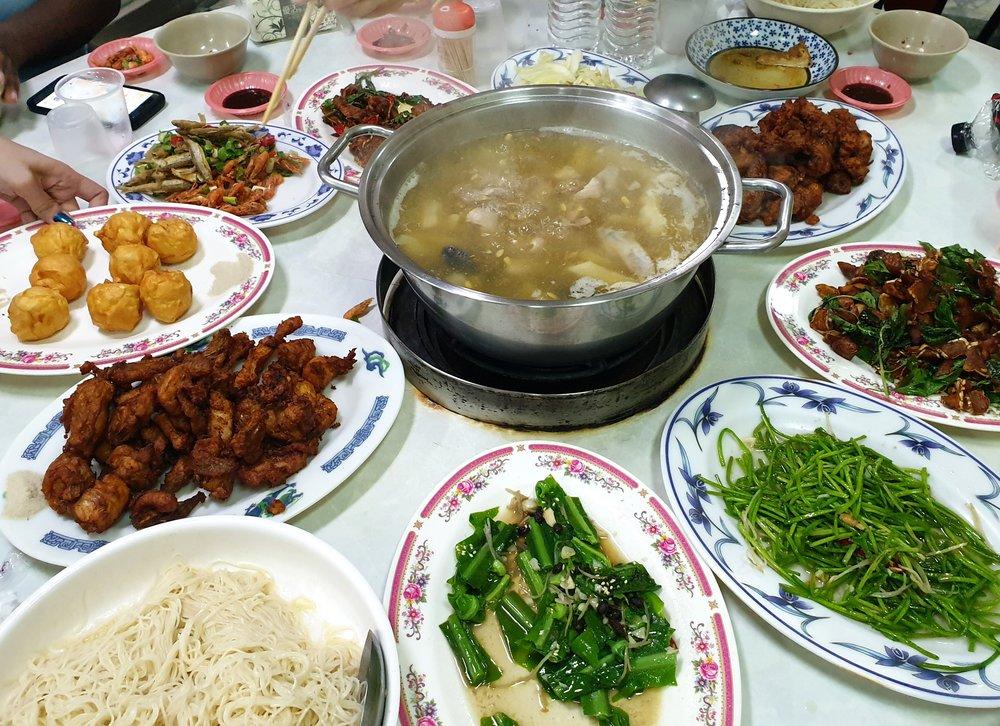 From top left: Fried shrimp, squid balls, tofu chicken, noodles, birds nest fern, water lily, ginger pork knuckle