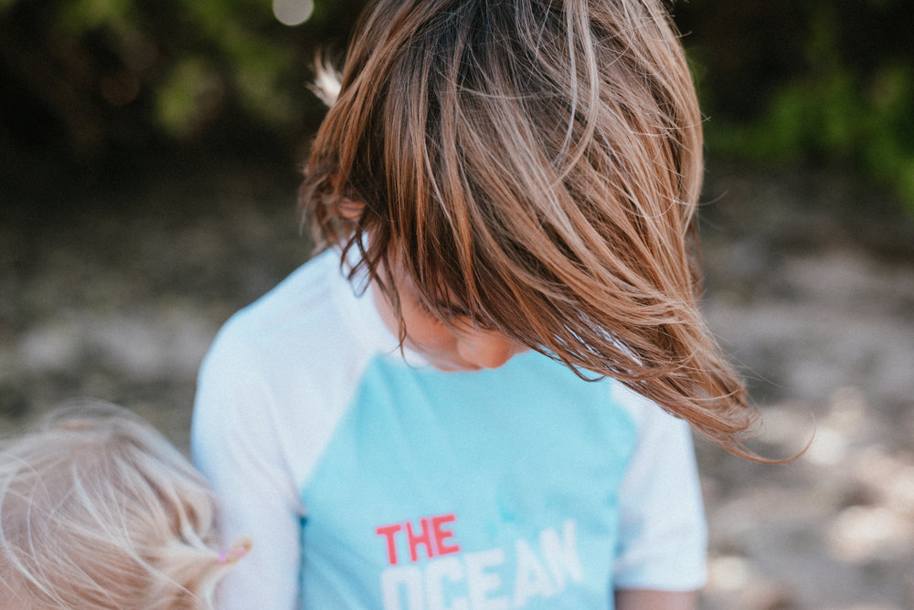 Boy with blonde streaks at the beach in Maui