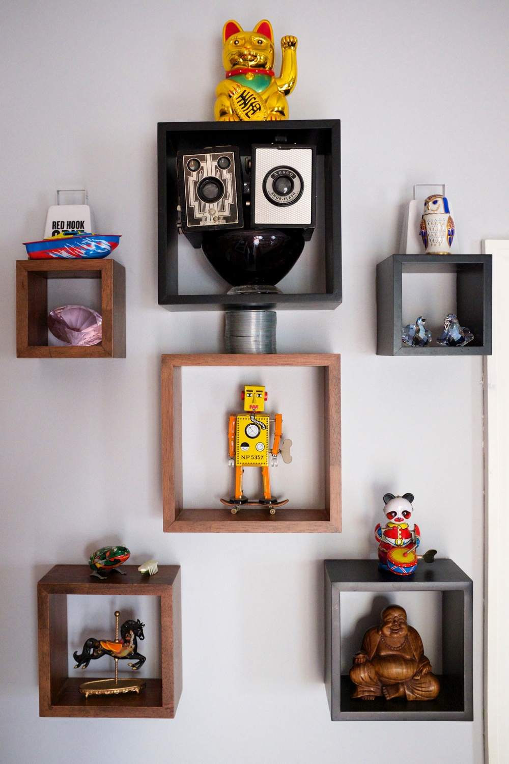 When we moved in I told Angel he could put up the shelves any way he wanted so he built me a shelf robot.