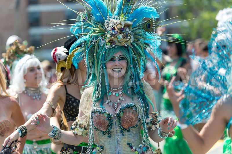 1403451188-the-colorful-and-outlandish-2014-coney-island-mermaid-parade_5071966.jpg