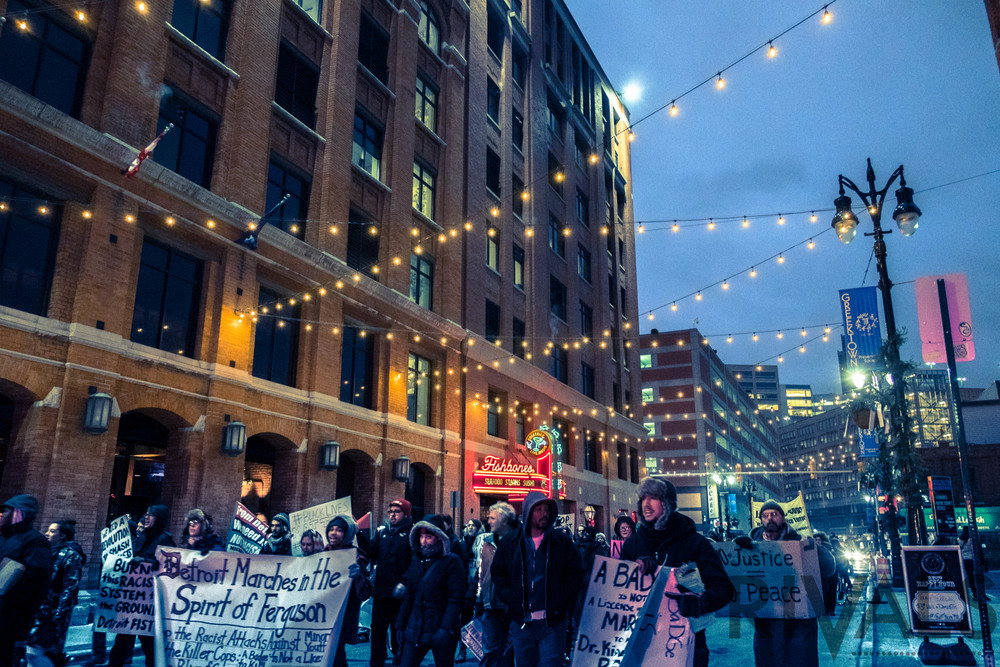 Protesters march through Detroit's Greektown area.