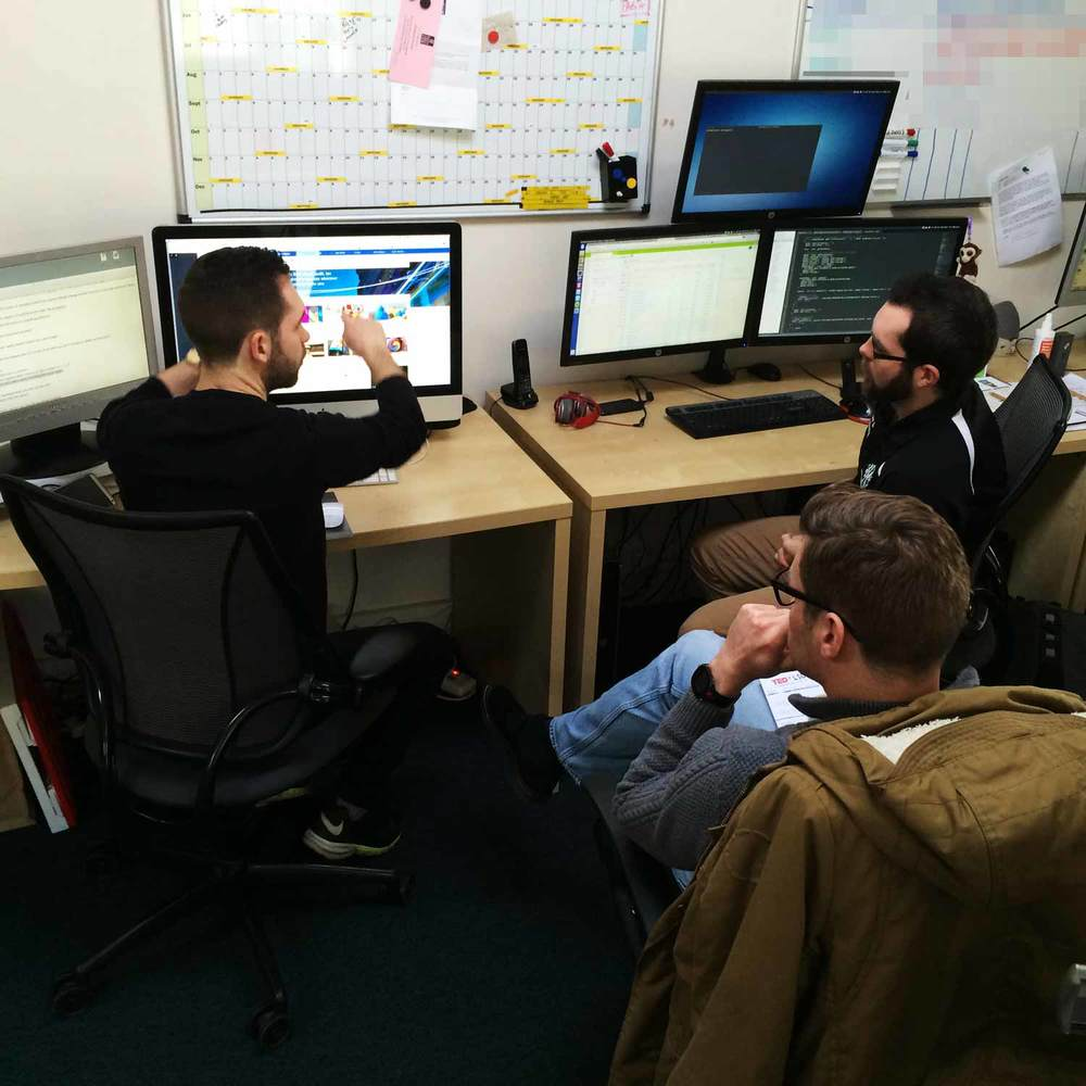 Designer Greg discusses the high-fidelity mock-ups with Lead Developer Jordan and Head-of-Traffic Adam Fisher