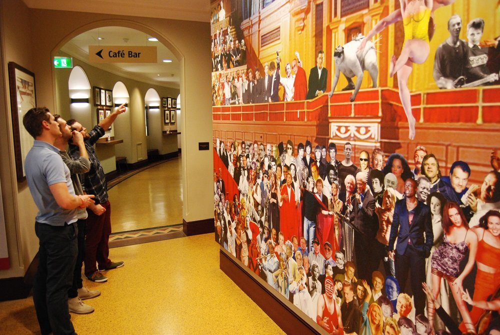 "3B web team by mural of ""Appearing at the Royal Albert Hall"""