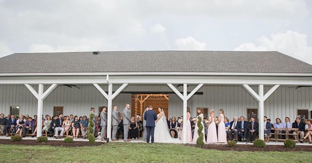 Get married under the overhang in front of our pond with the fountain in the background. @danamariephotographyoc @trishb176 @kylanbarn #raindays #wedding #barn #barnvenue #builtforlovewithlove #authenticweddings #weddingwire #ourbarn #bride #weddingday @coastaltentedevents