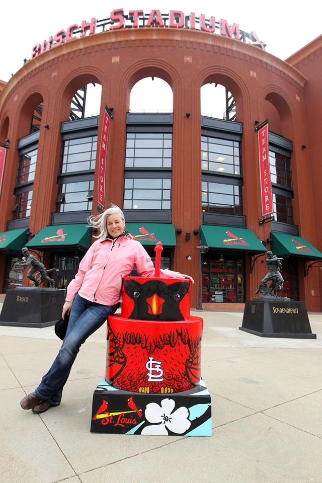 "Artist Katherine Nelson leans against ""Cardinal Cake"" at Busch Stadium, St. Louis, Missouri, USA  Photo: William Greenblatt/UPI."