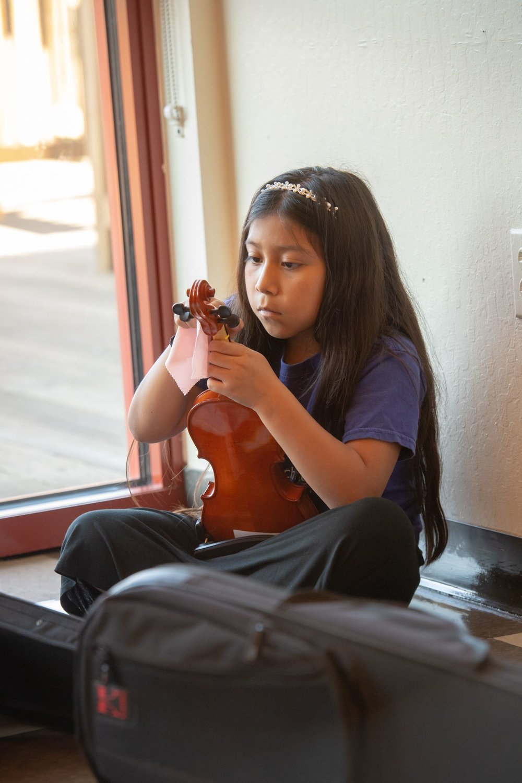 Isabella cleaning violin.jpg